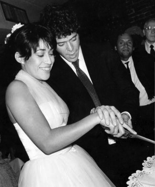 This is Sylvia Morales and Lou Reed at their wedding. Looks like Steve Rubell and William Burroughs in the background, but who knows?